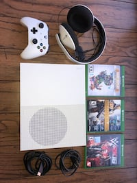 white Xbox One console with controller and game cases null