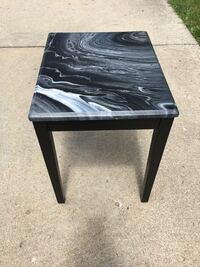 """Fluid art side table. Black, white, silver. Size is 17"""" x 21"""". Livonia, 48152"""