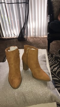 pair of brown leather booties Fontana