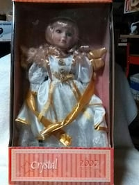 porcelain doll with white dress