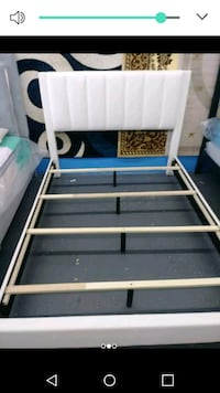 white and blue wooden bed frame