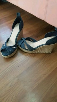 pair of black leather open-toe wedge sandals Lloydminster, S9V 1N3