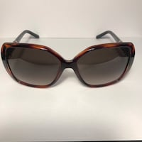 brown and black framed sunglasses 3128 km