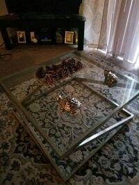 Glass with silver legs coffee table