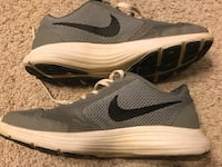 Pair of grey-and-white nike athletic shoes