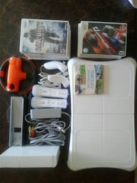 Wii console with accesories and 16 games. Calgary, T2W 3E1