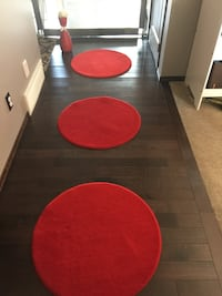 Three circle rugs , vase and 2red floated shelves Calgary, T3K 0V2
