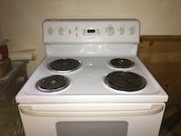 White electric coil range oven only two years old and used only a few times in prestige condition very clean! Ottawa, K4M 7M9
