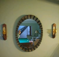 round mirror with brown wooden frame Mayfield Heights, 44124