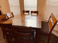 Dining Room table for 8. Includes 6 Chairs and a Bench
