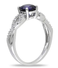 Blue Sapphire and Diamond Accent Twist Ring in 10K white gold Guelph