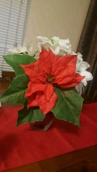 red and green faux flowers centerpiece 199 mi