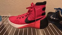pair of red Nike basketball shoes Springfield, 32404