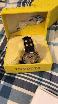 Round silver frame Invicta chronograph watch with black strap
