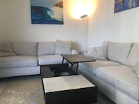 West Elm coffee table and two sofas and a side table from Living Spaces San Diego, 92101