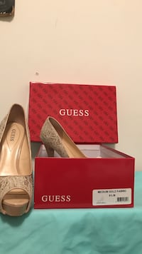 pair of gray leather Guess heeled shoes with box