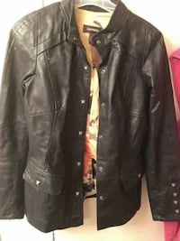 Xs leather jacket price negotiable  Calgary, T2R 0H9