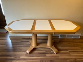 Large kitchen table with extension leaf.