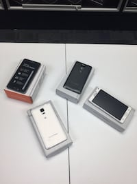 four black and white smartphones with boxes Lafayette, 70506