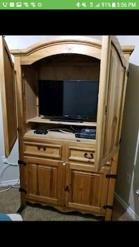 brown wooden TV hutch with flat screen television San Antonio, 78245