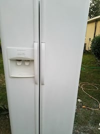 white Frigidaire side-by-side refrigerator with di