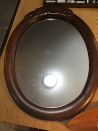 Antique, wood oval mirror Burke