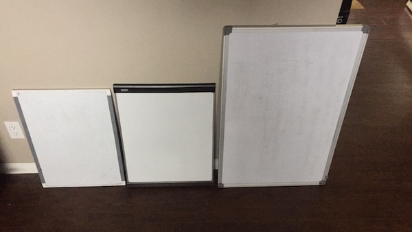 two white and black wooden boards