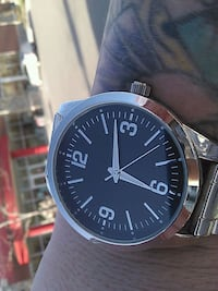 round silver analog watch with black leather strap Kelowna, V1W 3S9