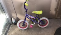 toddler's blue and green bicycle Moreno Valley, 92557