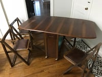rectangular brown wooden table with four chairs dining set Dickerson, 20842