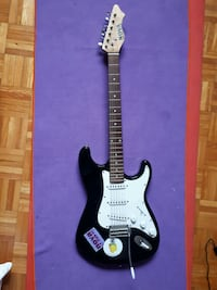 black and white stratocaster electric guitar 788 km