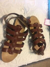 pair of brown leather gladiator sandals Orlando, 32803