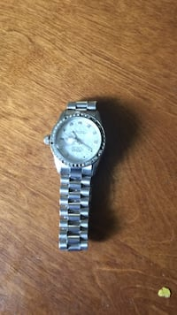 round silver and white analog watch with silver link band South Brunswick, 08852
