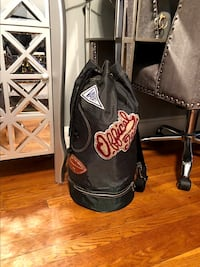 Men's vintage varsity bag good condition!  21 inches long lots of storage space. A great weekend or travel bag. Clean interior can be worn as a cross body bag or backpack.  Washington, 20002