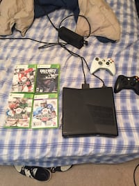 Xbox 360, 2 controllers, and games Valparaiso, 46383