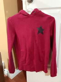 red with black star printed pull over hoodie