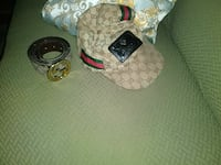 monogrammed brown Gucci cap with belt and buckle