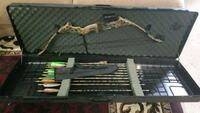 black and gray compound bow with arrows