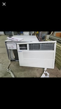 White window-type air conditioner and heater combo