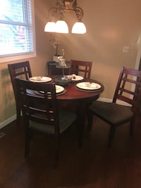 round brown wooden table with four chairs dining set Middletown, 10940