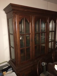 Solid wood dining room set. Hutch,table,6 chairs 2 of which are captains chairs. Bear, 19701