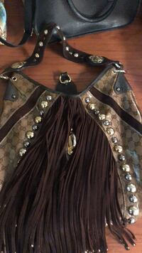 women's black and brown long-sleeved dress Toronto, M4E 1R4