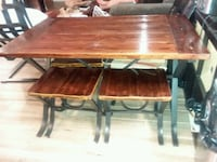 brown wooden table with chairs Mission