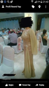 Women's gold sequined long-sleeve floor-length evening gown