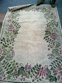 white, green, and purple floral area rug
