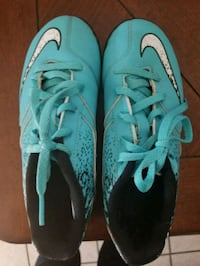 pair of teal-and-black Nike cleats