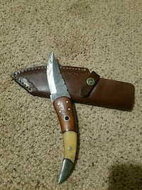 gray and beige trailing pocketknife with sheath