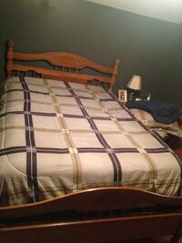 white, brown, and purple bedspread
