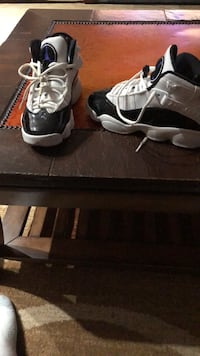 pair of black-and-white Air Jordan 11 Manassas, 20112