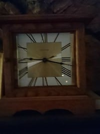 square white analog wall clock with brown wooden frame
